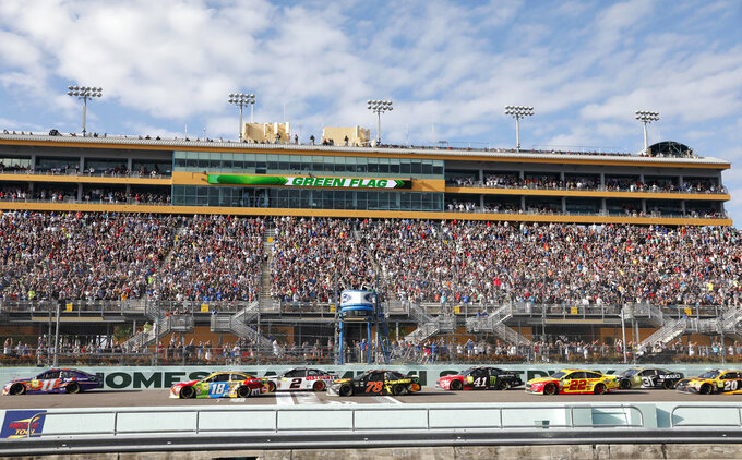 Drivers get the green flag at the start of the NASCAR Cup Series championship auto race at Homestead-Miami Speedway, Sunday, Nov. 18, 2018, in Homestead, Fla. (AP Photo/Terry Renna)