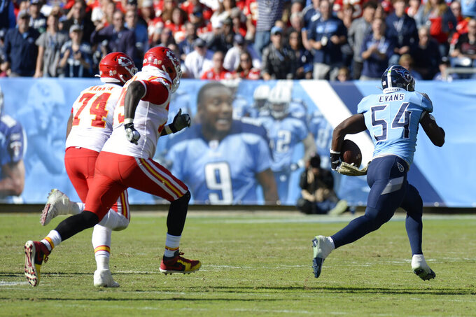 Tennessee Titans inside linebacker Rashaan Evans (54) runs back a fumble 53 yards for a touchdown as he is chased by Kansas City Chiefs offensive guard Martinas Rankin (74) and offensive tackle Cameron Erving (75) in the first half of an NFL football game Sunday, Nov. 10, 2019, in Nashville, Tenn. (AP Photo/Mark Zaleski)