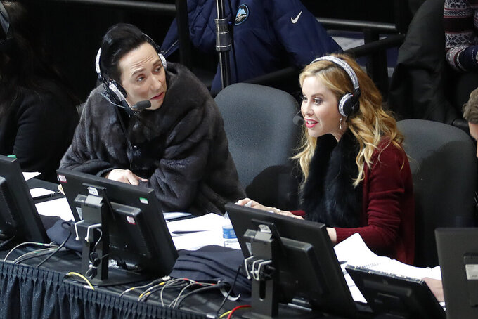 "Announcers Johnny Weir and Tara Lipinski talk during the women's free skate program at the U.S. Figure Skating Championships in Detroit. Tara Lipinski, the 1998 Olympic gold medalist and now the top TV analyst in the sport along with NBC partner Johnny Weir, recognizes how jumbled the figure skating scene is. ""The pre-Olympic season sets the tone of the Olympic season,"" says Lipinski, who will anchor coverage of Skate America this week on NBC, NBCSN and the Peacock streaming service. (AP Photo/Paul Sancya, File)"