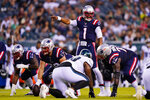 New England Patriots' Cam Newton directs his team during the first half of a preseason NFL football game against the Philadelphia Eagles on Thursday, Aug. 19, 2021, in Philadelphia. (AP Photo/Matt Rourke)