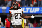 Cleveland Browns running back Kareem Hunt (27) celebrates his rushing touchdown during the first half of an NFL football game against the Los Angeles Chargers Sunday, Oct. 10, 2021, in Inglewood, Calif. (AP Photo/Gregory Bull)