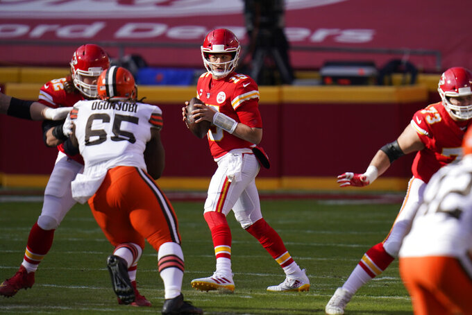Kansas City Chiefs quarterback Patrick Mahomes throws a pass during the first half of an NFL divisional round football game against the Cleveland Browns, Sunday, Jan. 17, 2021, in Kansas City. (AP Photo/Jeff Roberson)