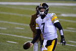 Pittsburgh Steelers' Ben Roethlisberger (7) tosses the ball as he leaves the field following an NFL football game against the Cincinnati Bengals, Monday, Dec. 21, 2020, in Cincinnati. (AP Photo/Michael Conroy)
