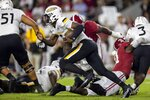 Southern Miss quarterback Ty Keyes (5) runs a sneak up the middle against Alabama during the first half of an NCAA college football game, Saturday, Sept. 25, 2021, in Tuscaloosa, Ala. (AP Photo/Vasha Hunt)