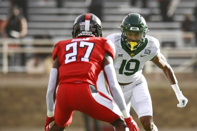 Baylor wide receiver Yusuf Terry (19) is covered by Texas Tech's Alex Hogan (27) during an NCAA college football game in Lubbock, Texas, Saturday, Nov. 14, 2020. (AP Photo/Justin Rex)