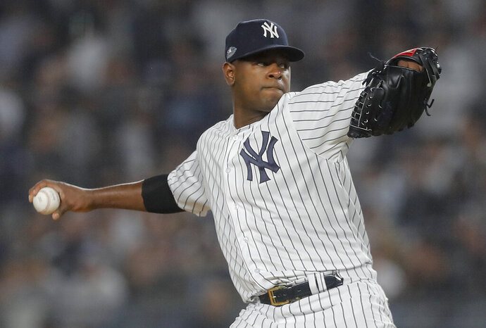 FILE - In this Oct. 8, 2018, file photo, New York Yankees starting pitcher Luis Severino delivers against the Boston Red Sox during the first inning of Game 3 of baseball's American League Division Series in New York. Severino is returning to New York to have more tests on his injured right shoulder. Yankees manager Aaron Boone says that Severino is not where he wants to be and they want to get him checked out to see why he is not progressing as expected. (AP Photo/Julie Jacobson, File)
