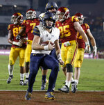 California quarterback Chase Garbers, center, scores against Southern California during the second half of an NCAA college football game in Los Angeles, Saturday, Nov. 10, 2018. California won 15-14. (AP Photo/Alex Gallardo)
