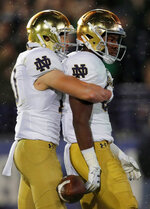 Notre Dame's Michael Young, right, celebrates his touchdown against Northwestern with Notre Dame's Chris Finke during the second half of an NCAA college football game Saturday, Nov. 3, 2018, in Evanston, Ill. (AP Photo/Jim Young)