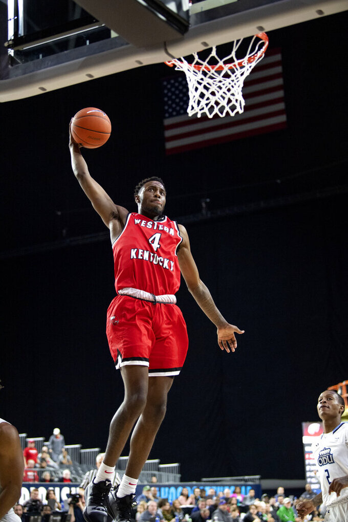 Western Kentucky guard Josh Anderson (4) goes up for a dunk against Old Dominion during the first half of an NCAA college basketball game for the Conference USA men's tournament championship, Saturday, March 16, 2019, in Frisco, Texas. (AP Photo/Jeffrey McWhorter)