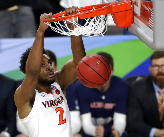 Virginia guard Braxton Key dunks the ball during the first half against Auburn in the semifinals of the Final Four NCAA college basketball tournament, Saturday, April 6, 2019, in Minneapolis. (AP Photo/Matt York)