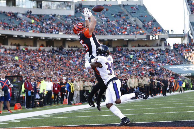 Cincinnati Bengals tight end Tyler Eifert (85) catches a touchdown pass against Baltimore Ravens cornerback Brandon Carr (39) during the first half of NFL football game, Sunday, Nov. 10, 2019, in Cincinnati. (AP Photo/Frank Victores)