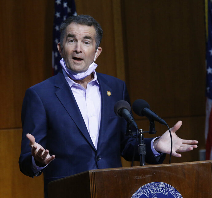 Virginia Gov. Ralph Northam answers a question during a press briefing inside the Patrick Henry Building in Richmond, Va. Thursday, June 25,, 2020. Virginia is launching a new program to help people struggling to pay their rent or mortgages amid the coronavirus pandemic. (Bob Brown/Richmond Times-Dispatch via AP)