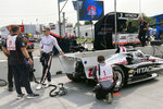 Tennessee native and two-time IndyCar champion Josef Newgarden leans on his car before he taking a ceremonial pace lap at the IndyCar auto race, Friday, Aug. 6, 2021, in Nashville, Tenn. (AP Photo/Dan Gelston)