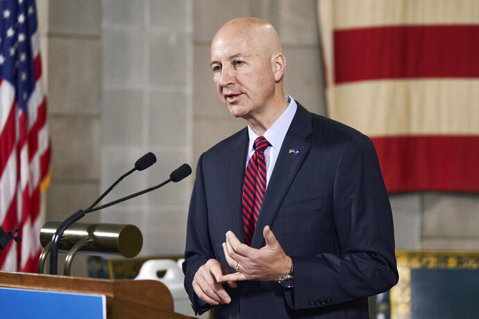 FILE - In this Sept. 30, 2020 file photo, Nebraska Gov. Pete Ricketts speaks during a news conference in Lincoln, Neb. Gov. Ricketts and other state officials unveiled the state's plan to distribute a coronavirus vaccination on Monday, Oct. 26, 2020, at the Capitol in Lincoln, Nebraska. (AP Photo/Nati Harnik File)