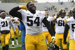 Iowa defensive tackle Daviyon Nixon (54) celebrates his teams 20-0 win against Northwestern during an NCAA college football game, Saturday, Oct. 26, 2019, in Evanston, Ill. (AP Photo/David Banks)