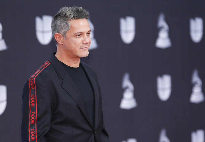 """FILE - Alejandro Sanz arrives at the 20th Latin Grammy Awards on Nov. 14, 2019, in Las Vegas. Sanz performed """"Imagine"""" by John Lennon and Yoko Ono, with John Legend, Keith Urban and Angelique Kidjo via pre-recorded video at the opening ceremony of the Tokyo Olympics on July 23, 2021. (Photo by Eric Jamison/Invision/AP, File)"""
