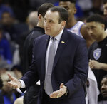 Duke head coach Mike Krzyzewski questions a call against Florida State during the first half of the NCAA college basketball championship game of the Atlantic Coast Conference tournament in Charlotte, N.C., Saturday, March 16, 2019. (AP Photo/Chuck Burton)