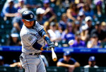 San Diego Padres' Luis Urias hit a home run in the second inning of a baseball game against the San Diego Padres, Sunday, Sept. 15, 2019, in Denver. (AP Photo/Parker Seibold)