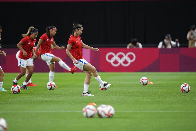 Chile's players warm up prior to a women's soccer match against Britain at the 2020 Summer Olympics, Wednesday, July 21, 2021, in Sapporo, Japan. (AP Photo/Silvia Izquierdo)