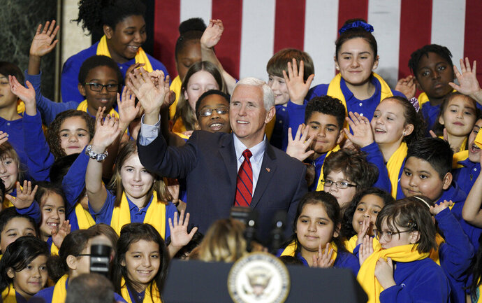 Vice President Mike Pence poses with kids after his speech. On Tuesday, Jan. 28, 2020, Vice President Pence traveled to Madison, Wisc., to  deliver remarks at the Wisconsin School Choice Student Showcase at the Wisconsin State Capitol. (Steve Apps/Wisconsin State Journal via AP)