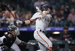 San Francisco Giants' Mike Yastrzemski watches his RBI single off Colorado Rockies relief pitcher Daniel Bard during the ninth inning of a baseball game Tuesday, Sept. 7, 2021, in Denver. The Giants won 12-3. (AP Photo/David Zalubowski)