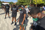 Members of the Baylor football team including Dave Aranda, bow their heads during a prayer after marching around campus, Thursday, Aug. 27, 2020, in Waco, Texas, protesting the shooting of Jacob Blake in Wisconsin. (Rod Aydelotte/Waco Tribune-Herald via AP)