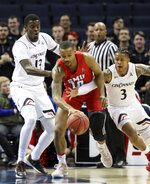 SMU guard William Douglas fights to keep control of the ball from Cincinnati's Rashawn Fredericks and Tre Scott during the first half of an NCAA college basketball game at the American Athletic Conference men's tournament Friday, March 15, 2019, in Memphis, Tenn. (AP Photo/Troy Glasgow)