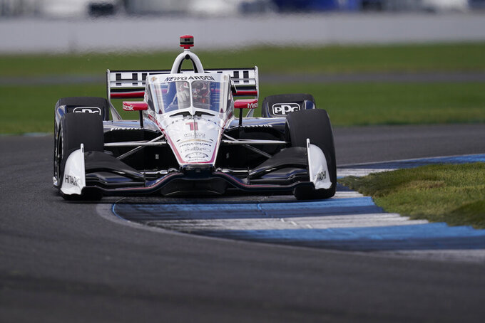 Josef Newgarden steers his car during a practice session for an IndyCar auto race at Indianapolis Motor Speedway, Thursday, Oct. 1, 2020, in Indianapolis. (AP Photo/Darron Cummings)
