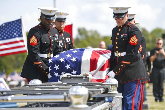Marine Corps honor guards prepare to place Marine Cpl. Humberto Sanchez' casket on a lowering device during the graveside service at Mount Hope Cemetery in Logansport, Ind., on Tuesday, Sept. 14, 2021. Sanchez was one of 13 U.S. service members killed in last month's suicide bombing at Afghanistan's Kabul airport during the U.S.-led evacuation.  (Jonah Hinebaugh/The Pharos-Tribune via AP)