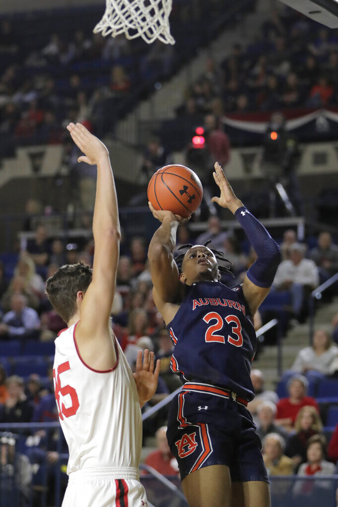 Auburn forward Isaac Okoro (23) goes up for a shot against Davidson forward Luka Brajkovic (35) during the first half of an NCAA college basketball game at the Veterans Classic Tournament, Friday, Nov. 8, 2019, in Annapolis, Md. (AP Photo/Julio Cortez)