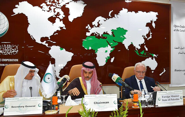 """In this photo released by the the Organization of Islamic Cooperation (OIC), from right to left, Palestinian Foreign Minister Riyad al-Maliki, Saudi Foreign Minister Prince Faisal bin Farhan Al Saud, center, and the organization Secretary General, Yousef bin Ahmed Al-Othaimeen, chair an emergency ministerial meeting in Jiddah, Saudi Arabia, Monday, Feb, 3, 2020. Days after Gulf Arab states expressed their support for President Donald Trump's efforts at resolving the Israeli-Palestinian conflict, representatives of Muslim-majority nations gathered in Saudi Arabia and rejected the White House's plan as """"biased."""