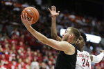 Oregon State forward Tres Tinkle, left, shoots next to Washington State guard Noah Williams during the second half of an NCAA college basketball game in Pullman, Wash., Saturday, Jan. 18, 2020. Washington State won 89-76. (AP Photo/Young Kwak)