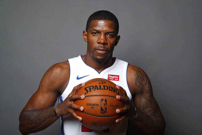FILE - In this Sept. 20, 2019, file photo, Detroit Pistons guard Joe Johnson poses during the NBA basketball team's media day in Auburn Hills, Mich. The Pistons now have the top picks from the 2008 and 2009 NBA drafts in Derrick Rose and Blake Griffin. Rose, Griffin and Johnson have combined for 16 All-Star selections, although the last time they made it at the same time was in 2012. (AP Photo/Carlos Osorio, File)