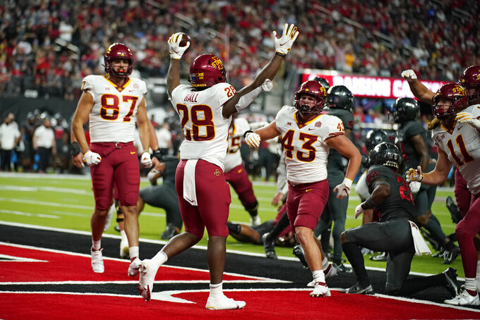 Iowa State running back Breece Hall (28) celebrates after scoring a touchdown against UNLV during the first half of an NCAA college football game Saturday, Sept. 18, 2021, in Las Vegas. (AP Photo/John Locher)