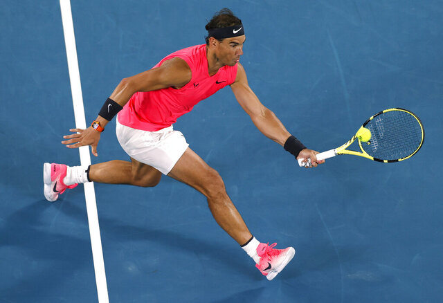 Spain's Rafael Nadal makes a forehand return to Australia's Nick Kyrgios during their fourth round singles match at the Australian Open tennis championship in Melbourne, Australia, Monday, Jan. 27, 2020. (AP Photo/Andy Wong)