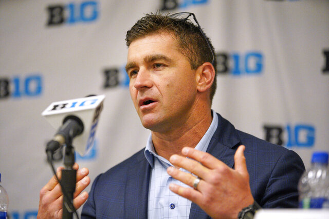 FILE - In this May 21, 2019 file photo, Michigan coach Erik Bakich speaks during a news conference ahead of the Big Ten NCAA college baseball tournament, in Omaha, Neb. Michigan showed no sign of being a one-hit wonder on the first weekend of the college baseball season. The 2019 national runner-up Wolverines knocked off top-10 opponents Vanderbilt and Arizona State and finished their trip to the Phoenix area with a 3-1 record. The success in the desert earned Michigan a move into the top 10 in the major polls Monday, Feb. 17, 2020. (AP Photo/Nati Harnik, File)