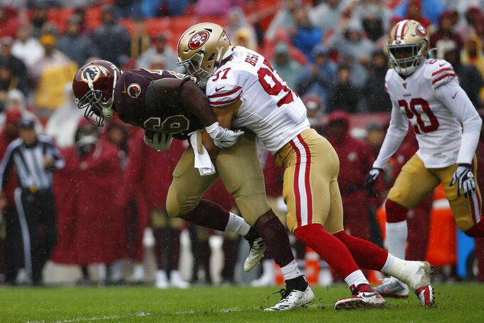 San Francisco 49ers defensive end Nick Bosa, right, tackles Washington Redskins running back Adrian Peterson in the first half of an NFL football game, Sunday, Oct. 20, 2019, in Landover, Md. (AP Photo/Alex Brandon)