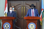 Egypt's President Abdel-Fattah el-Sissi, left, and South Sudan's President Salva Kiir, right, make a statement to the media after meeting at the president's office in the capital Juba, South Sudan Saturday, Nov. 28, 2020. The Egyptian president is on a one-day visit to discuss bilateral relations. (AP Photo/Maura Ajak)