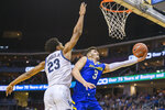 Villanova forward Jermaine Samuels (23) defends Delaware guard Nate Darling (3) during the first half of the Never Forget Tribute Classic NCAA college basketball game, Saturday, Dec. 14, 2019, in Newark, N.J. (AP Photo/Corey Sipkin)