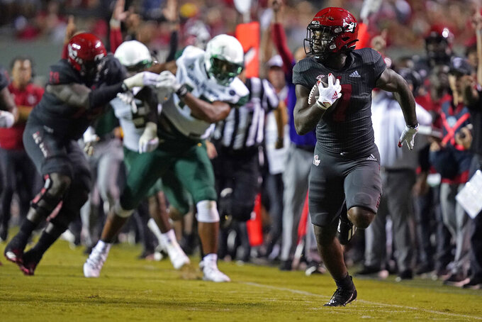 North Carolina State running back Zonovan Knight runs for a touchdown against South Florida during the second half of an NCAA college football game in Raleigh, N.C., Thursday, Sept. 2, 2021. (AP Photo/Gerry Broome)