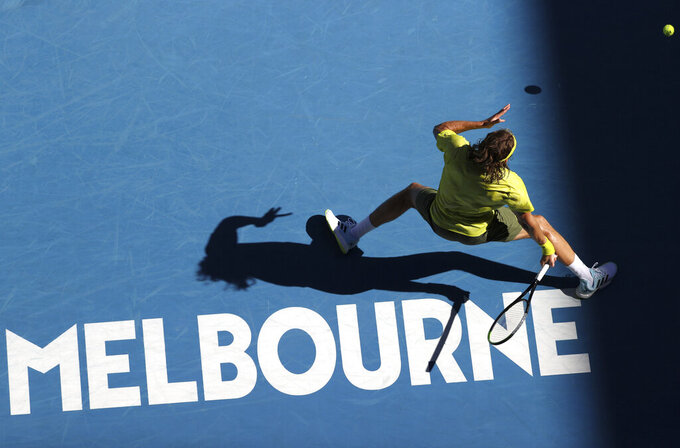 Greece's Stefanos Tsitsipas hits a forehand to Sweden's Mikael Ymer during their third round match at the Australian Open tennis championships in Melbourne, Australia, Saturday, Feb. 13, 2021. (AP Photo/Hamish Blair)