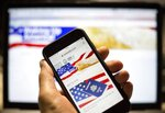 FILE - In this file photo taken on Sunday, July 15, 2018, The USAReally website is seen on an iPhone screen in Moscow, Russia. Russian-run website USAReally, which purports to cover news
