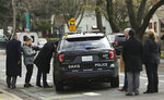 Authorities inspect the patrol vehicle driven by Davis Police Officer Natalie Corona, Friday, Jan. 11, 2019, in Davis, Calif. Corona, 22, who had been on the job only a few weeks, was shot and killed Thursday. The suspect was later found dead from a self-inflicted gunshot. (AP Photo/Rich Pedroncelli)