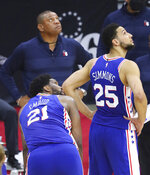 Philadelphia 76ers center Joel Embiid, head coach Doc Rivers, and guard Ben Simmons look at the clock during a time out after Embiid missed both his free throws with 10 seconds left in game 5 during a 109-106 loss to the Atlanta Hawks in their NBA Eastern Conference semifinals series on Wednesday, Jun 16, 2021, in Philadelphia. (Curtis Compton/Atlanta Journal-Constitution via AP)