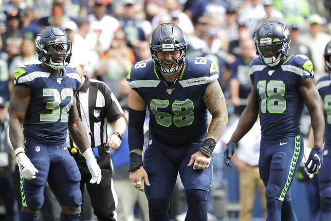 Seattle Seahawks center Justin Britt (68) reacts after going down with an injury during the first half of an NFL football game against the Cincinnati Bengals, Sunday, Sept. 8, 2019, in Seattle. (AP Photo/John Froschauer)