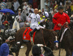Mike Smith celebrates after riding Justify to victory during the 144th running of the Kentucky Derby horse race at Churchill Downs Saturday, May 5, 2018, in Louisville, Ky. (AP Photo/Garry Jones)