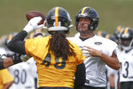 Pittsburgh Steelers quarterback Ben Roethlisberger (7) passes around linebacker Bud Dupree in a drill during practice at NFL football training camp in Latrobe, Pa., Thursday, Aug. 15, 2019. (AP Photo/Keith Srakocic)