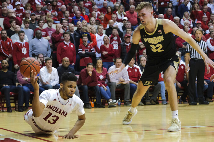 Indiana forward Juwan Morgan (13) loses a ball out of bounds in front of Purdue center Matt Haarms (32) during the second half of an NCAA college basketball game in Bloomington, Ind., Tuesday, Feb. 19, 2019. Purdue won 48-46. (AP Photo/AJ Mast)