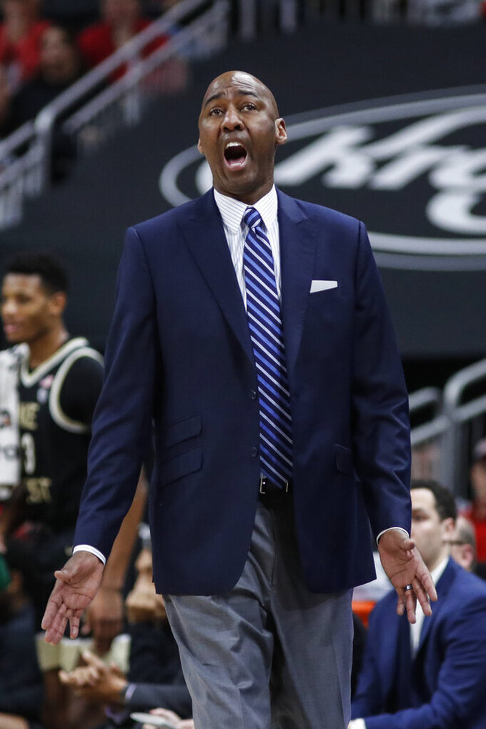 Wake Forest coach Danny Manning reacts to a call during the second half of the team's NCAA college basketball game against Louisville Wednesday, Feb. 5, 2020, in Louisville, Ky. Louisville won 86-76. (AP Photo/Wade Payne)