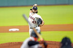 Houston Astros starting pitcher Lance McCullers Jr. (43) throws to San Francisco Giants' Donovan Solano during the first inning of a baseball game Monday, Aug. 10, 2020, in Houston. (AP Photo/David J. Phillip)